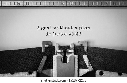Text A goal without a plan is just a wish typed on retro typewriter