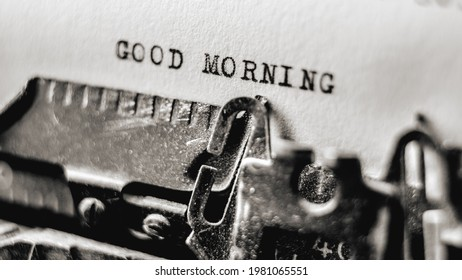 Text Good morning printed in old style on retro typewriter using black inks. Nostalgic typescript