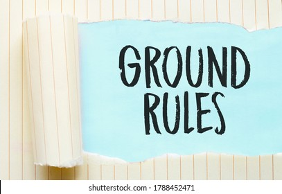 The text GROUND RULEs appearing behind torn white paper