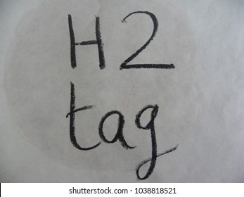 Text H2 tag hand written by black oil pastel on white color paper