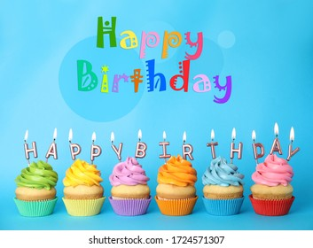 Text Happy Birthday and delicious cupcakes with burning candles on light blue background