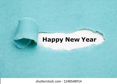 Text Happy New Year appearing behind ripped blue paper.