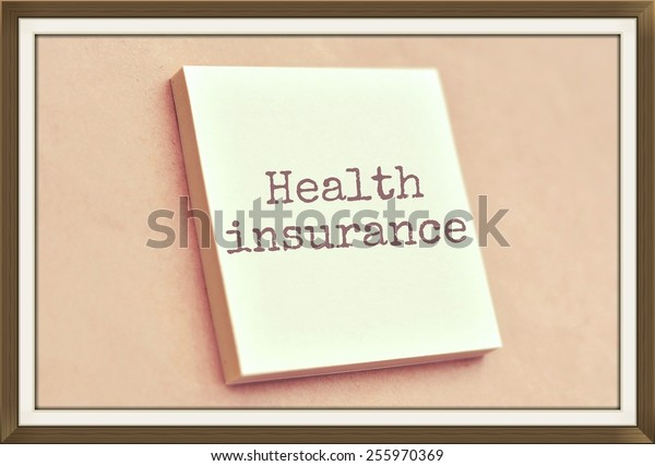 Text health insurance on the short note texture background