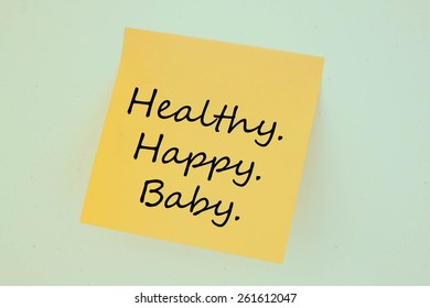 Text healthy happy baby on the short note texture background