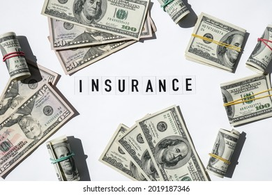 Text INSURANCE around US dollar banknotes. Health, life, home, car Insurance. Insurance business concept. Business budget of wealth and prosperity finance. Health care or medicare insurance