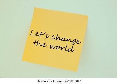 Text let us change the world on the short note texture background
