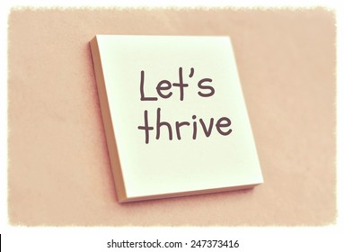 Text let's thrive on the short note texture background