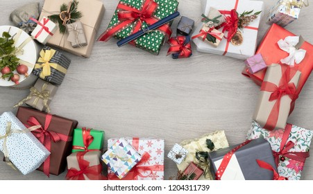 Text or logo empty copy space in vertical top view wooden table full of christmas or birthday gifts presents.Xmas winter holiday season party social media card background