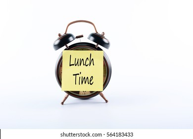 "Text ""Lunch Time"" on Notepad and Alarm Clock isolated on white background"