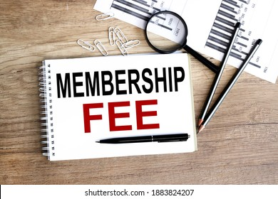 Text MEMBERSHIP, text on white paper on wood background