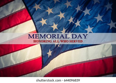 Text Memorial Day and Honor on flowing American flag background. Concept of Memorial day or Veteran's day in America.