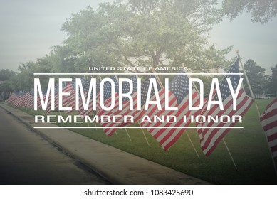 Text Memorial Day remember and honor on long row of lawn American Flags background. Green grass yard USA flags blow in the wind. Concept of Memorial day or Veteran's day in America.