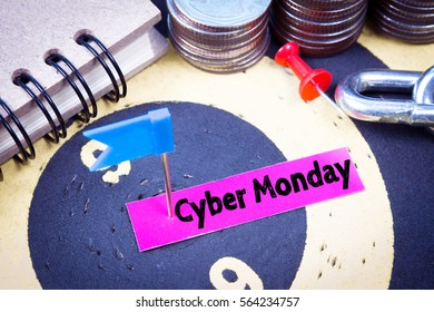Text message Cyber monday on pink paper with target center of dartboard