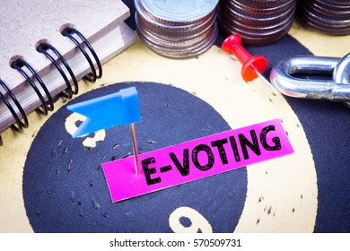 Text message E-voting on pink paper with target center of dartboard
