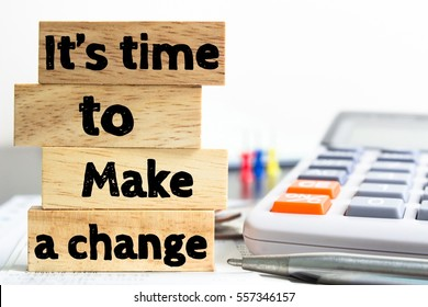 Text message It's Time to make a change on wooden with office table. Business concept