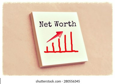 Text net worth on the graph goes up on the short note texture background