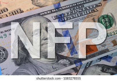 Text NFP( Non farm pay roll ) with background Dollar Bank Note , Business concept.