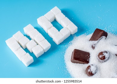 Text No is lined with sugar cubes with sweets candy. The concept of harm to the health of sweet and rejection of sucrose