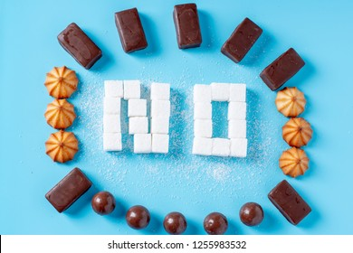 Text No is lined with sugar cubes with sweets and cookies. The concept of harm to the health of sweet and rejection of sucrose