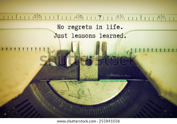 text No regrets in life just lessons learned  on the paper typewriter vintage color tone