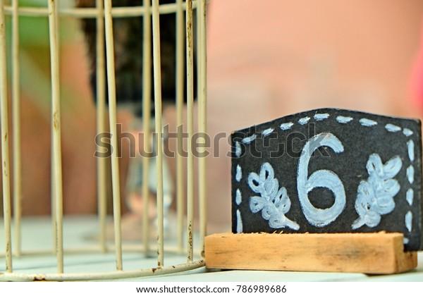 Text number six on black chalkboard,  number six written hand chalk on board