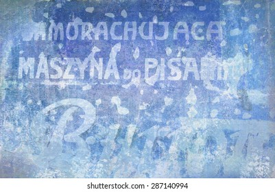 Text on old wall. Background of old cracked wall with Polish inscriptions. Ancient battered advertising wall inscription.