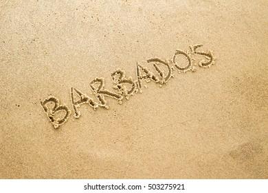 Text on sand on beach: barbados