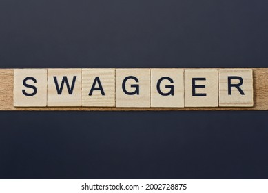 text on word swagger from gray wooden letters on a black background