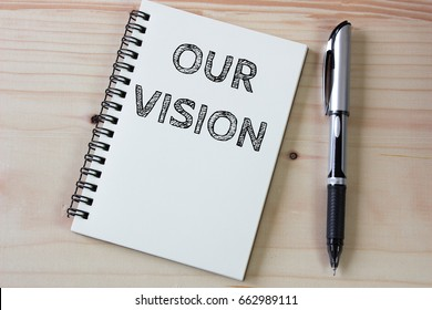 Text our vision on white paper and pen / business concept