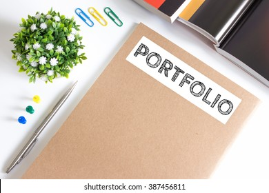 Text Portfolio on brown paper book on table / business concept