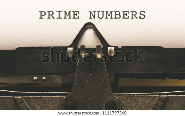 Text Prime Numbers on paper in vintage type writer machine from 1920s closeup