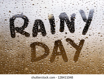 "Text ""RAINY DAY"" written in a crystal with many drops."