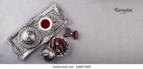 The text Ramadan Kareem means Blessed month of Ramadan with dates fruit and arabic coffee cup