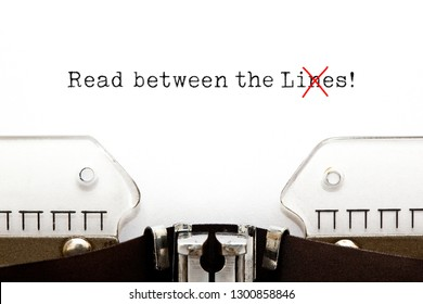Text Read Between The Lies typed on vintage typewriter. The usually used word in the original idiom Lines is changed to Lies.