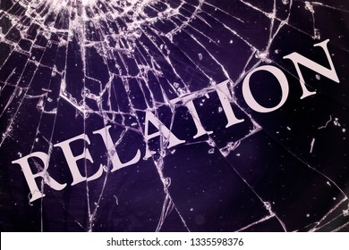 """The text """"Relation"""" on the broken glass. Quarrel or conflict concept."""