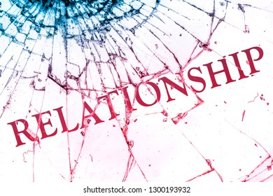 """The text """"Relationship"""" on the broken glass. Conflict or loneliness concept."""