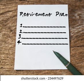 Text retirement plan on paper and wood