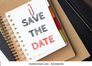 Text Save the date on white paper on the laptop computer / business concept