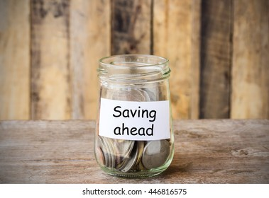 Text for Saving ahead,concept money in the glass with filter effect retro vintage style