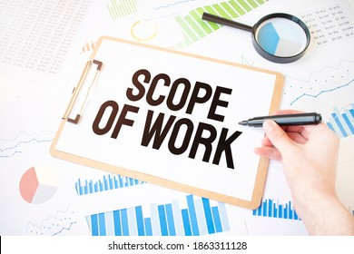Text Scope Of Work on white paper sheet and marker on businessman hand on the diagram. Business concept