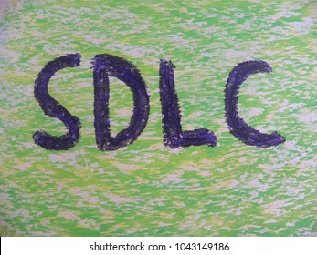 Text SDLC hand written by colorful oil pastels