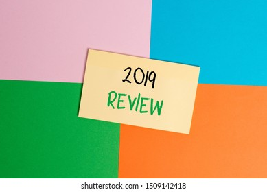Text sign showing 2019 Review. Conceptual photo New trends and prospects in tourism or services for 2019 Office appliance colorful square desk study supplies empty paper sticker.