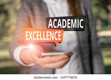 Text sign showing Academic Excellence. Conceptual photo Achieving high grades and superior perforanalysisce Woman in grey suites holds mobile phone.