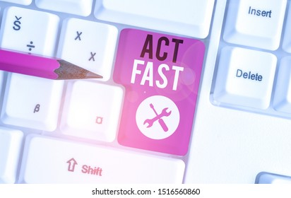 Text sign showing Act Fast. Conceptual photo Voluntarily move in the highest state of speed initiatively White pc keyboard with empty note paper above white background key copy space.