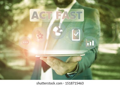 Text sign showing Act Fast. Conceptual photo Voluntarily move in the highest state of speed initiatively Male human wear formal work suit presenting presentation using smart device.