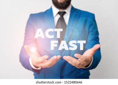 Text sign showing Act Fast. Conceptual photo Voluntarily move in the highest state of speed initiatively Man with opened hands in fron of the table. Mobile phone and notes on the table.
