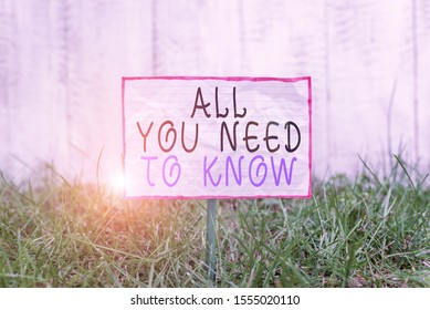 Text sign showing All You Need To Know. Conceptual photo Tell only the Facts and Important ones Access to Data Crumpled paper attached to a stick and placed in the green grassy land.