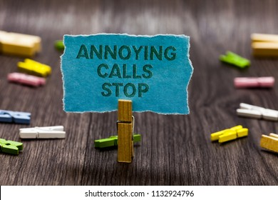 Text sign showing Annoying Calls Stop. Conceptual photo Prevent spam phones Blacklisting numbers Angry caller Clips symbol idea script notice board text capital cardboard design.