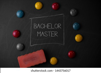 Text sign showing Bachelor Master. Conceptual photo An advanced degree completed after bachelor s is degree Round Flat shape stones with one eraser stick to old chalk black board.