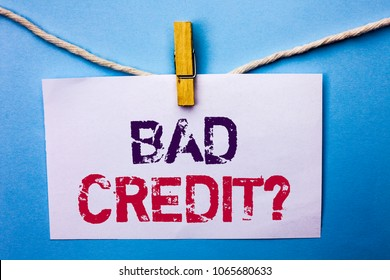 Text sign showing Bad Credit Question. Conceptual photo Low Credit Finance Economic Budget Asking Questionaire written on White Note Paper hanging with rope on the plain background Clip.